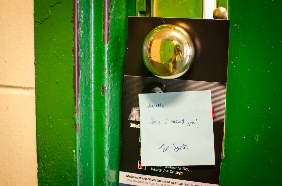 Santos leaves a personalized note for residents who are not at home.